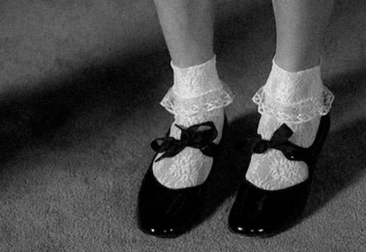 black and white Inspiration friday image of a girl in cute black shoes