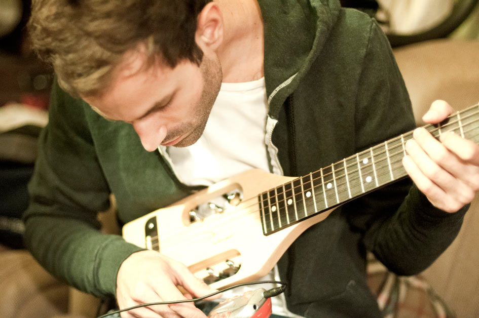 Foster the people Guitar player and singer Sean Cimino playing a custom guitar photo by Danny Roberts
