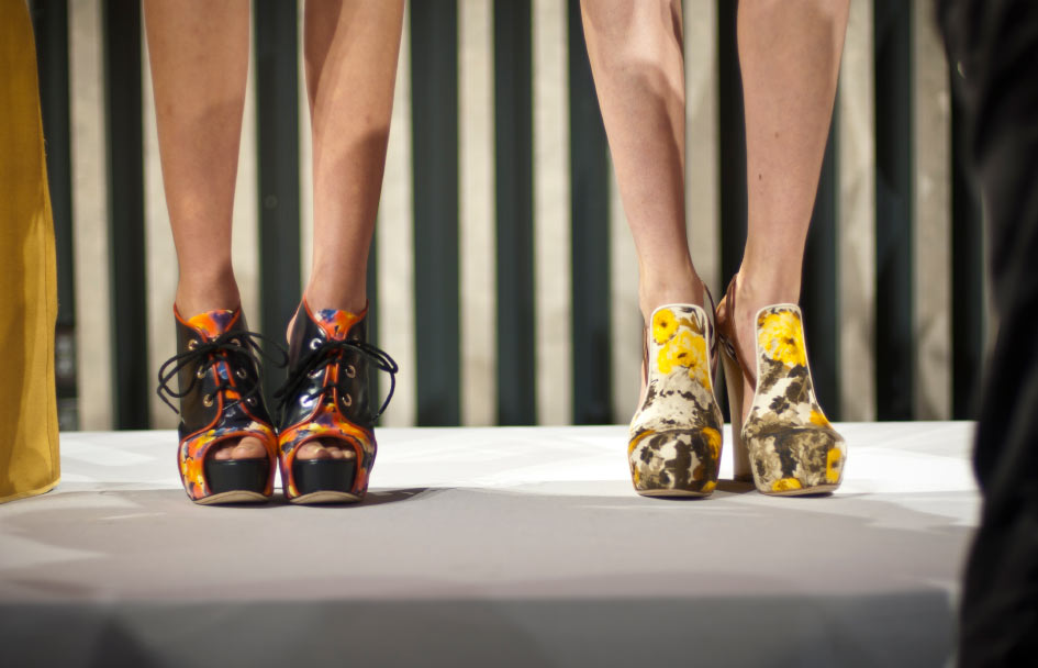 icture of two girls models feet at chris benz spring 2011 collection wearing beautiful black orange and other girl wearing yellow and green shoes with a amazing floral pattern at new york fashion week Photo by Danny Roberts