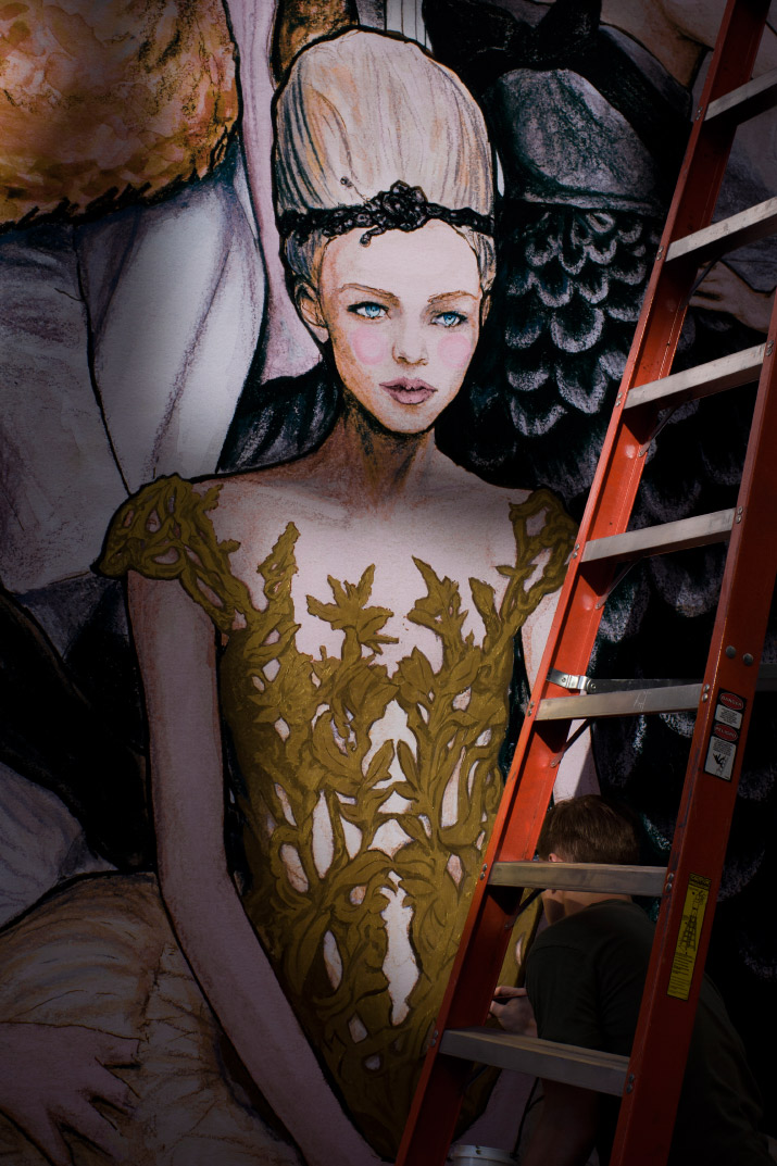 Fashion Artist Danny Roberts  Painting gold on the dress inspired by Marchesa dress for his mural at new Tiffany and company store on soho new york photo by his sister Mandi Roberts