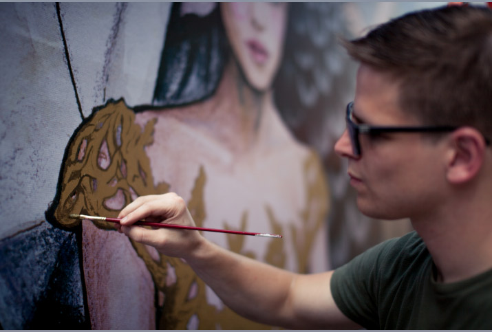 Photographer Nick Bowser photo of Fashion Artist Danny Roberts standing Painting details on Tiffanys store mural in soho new york