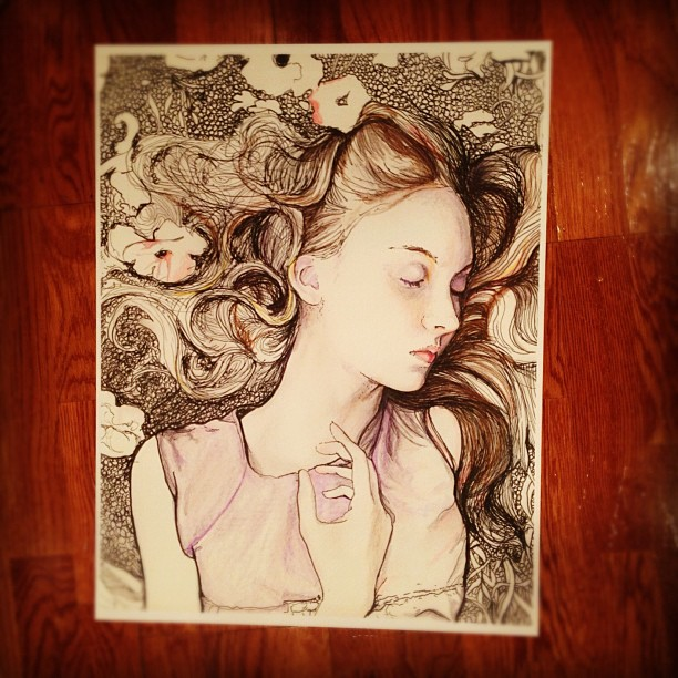 Artist Danny roberts working drawings of Fashion Model Codie Young just adding color