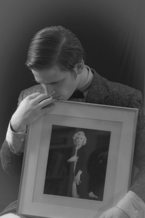 Artist Danny Roberts Holding a Picture of marilyn monroe