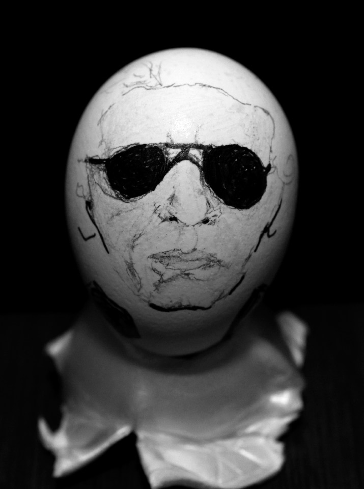 A black and white photo of karl lagerfeld drawn onto a eggs by artist danny roberts