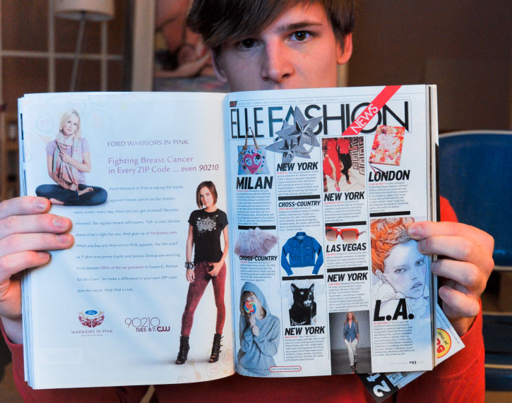 Danny Roberts Holding his feature in US Elle Magazine
